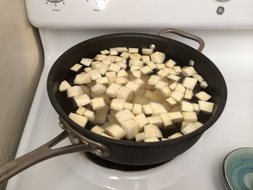 Boiling parsnips and potatoes for the dumplings