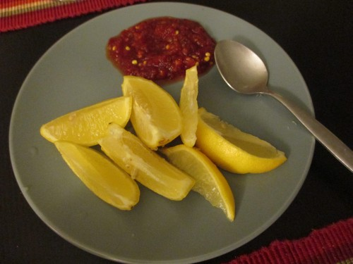 Sambal oelek (savory chili paste) and lemon wedges to accompany the Mee goreng