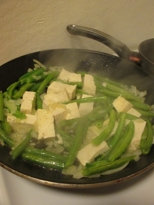 tofu and green beans cooking in peanut oil
