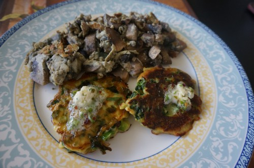 Green pancakes with lime butter with scrambled eggs with mushrooms and onions