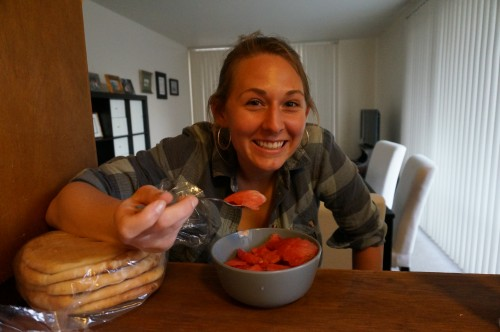 Claire enjoying some watermelon while I make the fattoush