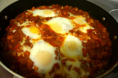 Shakshuka with the eggs cooking