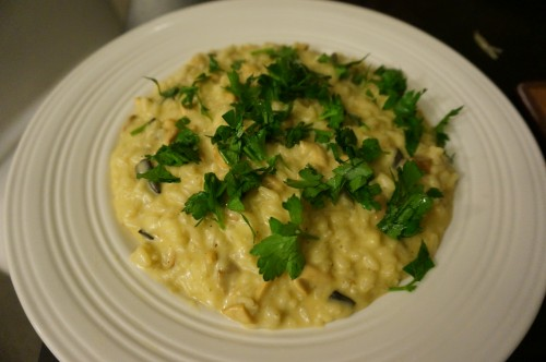 Wild mushroom risotto with parsley sprinkled on top
