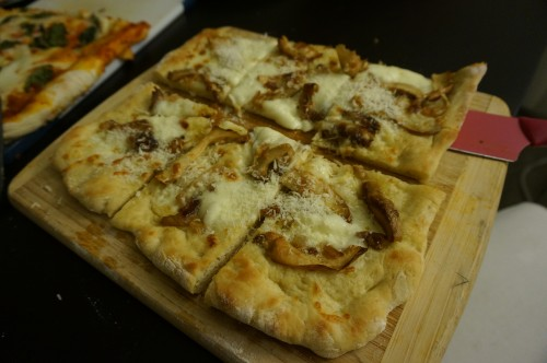 Final product: home made Matsutake pizza with mozzarella and parmesan reggiano sprinkled on top