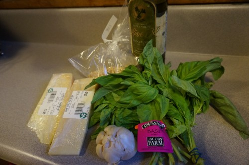 Ingredients for the pesto: olive oil, garlic, basil, pine nuts, parmesan cheese.