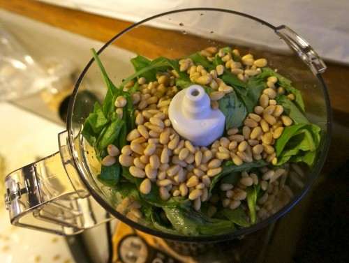 Pine nuts and basil in the food processor