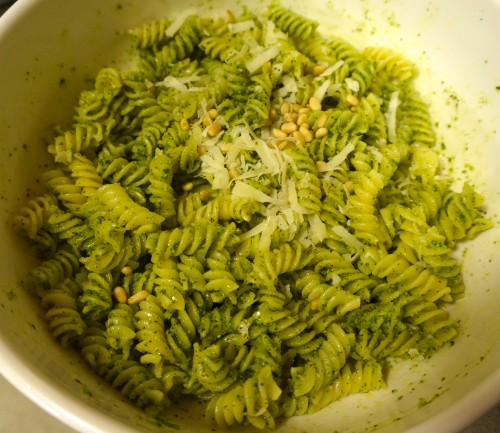Home made pesto mixed with  pasta topped with extra pine nuts and Parmesan.